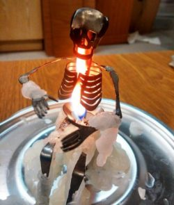 Skeleton-shaped candle holder