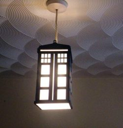 Ceiling light is designed in the shape of two doors of the house