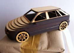 Wooden cars are cut by a laser