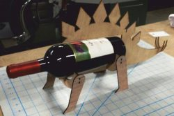Stegosaurus shaped wine bottle holder file cdr and dxf free vector download for Laser cut CNC